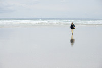 Woman walking alone on the beach in Britain France